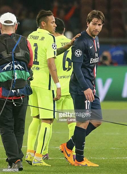 Maxwell of Paris SaintGermain is congrat by Neymar jr of Barcelona FC after the UEFA Champions League Quarter Final First leg between Paris...