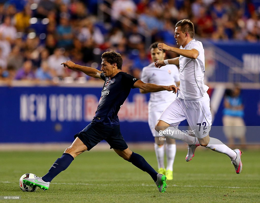 Maxwell #17 of Paris Saint-Germain takes the ball as Josip Ilicic #72 of AFC Fiorentina defends during the International Champions Cup at Red Bull Arena on July 21, 2015 in Harrison, New Jersey.Paris Saint-Germain defeated ACF Fiorentina 4-2.
