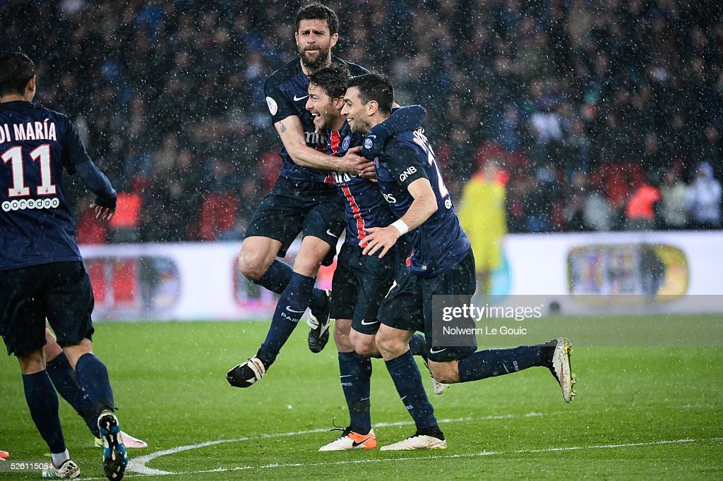 Maxwell of PSG celebrates his goal with Thiago Motta and Javier Pastore during the French Ligue 1 match between Paris Saint Germain PSG and Stade Rennais at Parc des Princes on April 29, 2016 in Paris, France.