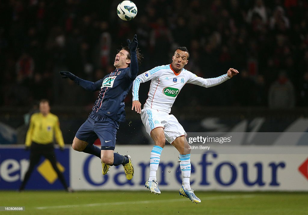 Maxwell Scherrer of PSG and Foued Kadir of OM in action during the French Cup match between Paris Saint Germain FC and Olympique de Marseille OM at the Parc des Princes stadium on February 27, 2013 in Paris, France.