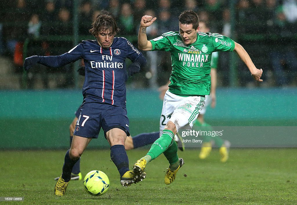 Maxwell Scherrer of PSG and Romain Hamouma of Saint-Etienne in action during the Ligue 1 match between AS Saint-Etienne ASSE and Paris Saint-Germain FC at the Stade Geoffroy-Guichard on March 17, 2013 in Saint-Etienne, France.