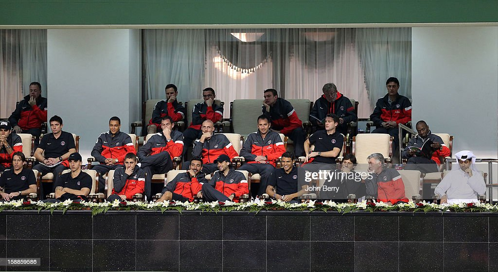Maxwell, Zlatan Ibrahimovic, Marco Verratti, Ezequiel Lavezzi, Javier Pastore, Thiago Motta, Leonardo, Carlo Ancelotti, Nasser Al-Khelaifi, (L-R second raw) Gregory Van Der Wiel, Paul Clement of PSG watch David Ferrer of Spain against Dustin Brown of Germany during their first round match on day two of the Qatar Open 2013 at the Khalifa International Tennis and Squash Complex on January 1, 2013 in Doha, Qatar.