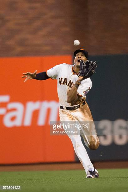 San Francisco Giants right fielder Justin Maxwell dives to catch a deep fly ball in the 4th inning during the MLB game between the San Francisco...
