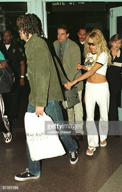 May 06 1999 Los Angeles Ca The Recently Reconciled Pamela Lee Anderson And Her Husband Tommy Lee Face The Cameras As They Arrive At Los Angeles...