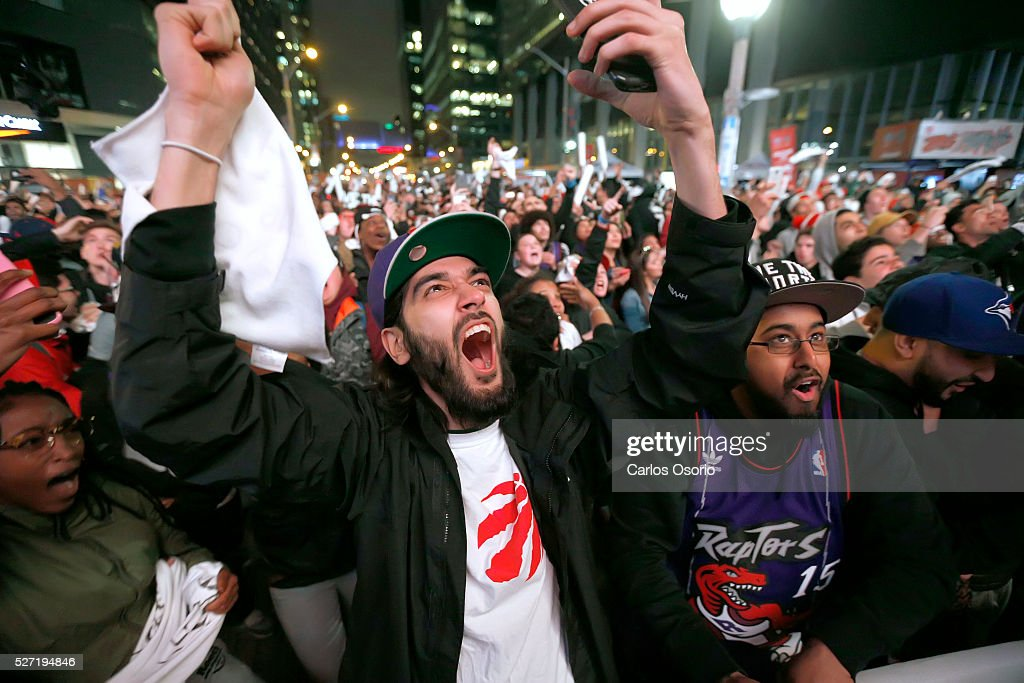 TORONTO, ON - May 1 - Fans are seen at Jurassic Park outside the Air Canada Centre while the Toronto Raptors take on the Indiana Pacers during game 7 of their NBA playoff game on May 1, 2016.