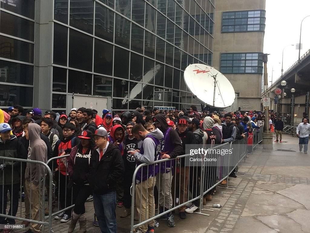 TORONTO, ON - May 1 - Fans waiting get into Air Canada Centre before the Toronto Raptors take on the Indiana Pacers during game 7 of their NBA playoff game on May 1, 2016.