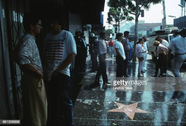 LOS ANGELES May 1 Rodney King Riot View of police officers standing in riot helmets and merchants inspecting damage to their businesses along the...