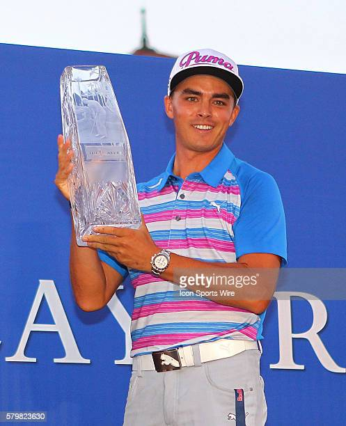Ricky Fowler shows off the championship trophy in the final round of The Players Championship at TPC Sawgrass Ponte Vedra Beach Florida