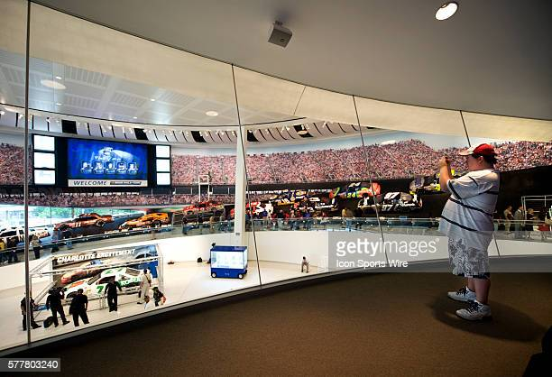 A NASCAR fan snaps a photo of the Great Hall from inside the Skybox viewing during the NACAR Hall of Fame Grand Opening in Charlotte North Carolina