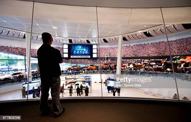 NASCAR fans look over the Great Hall from inside the Skybox viewing during the NASCAR Hall of Fame Grand Opening in Charlotte North Carolina