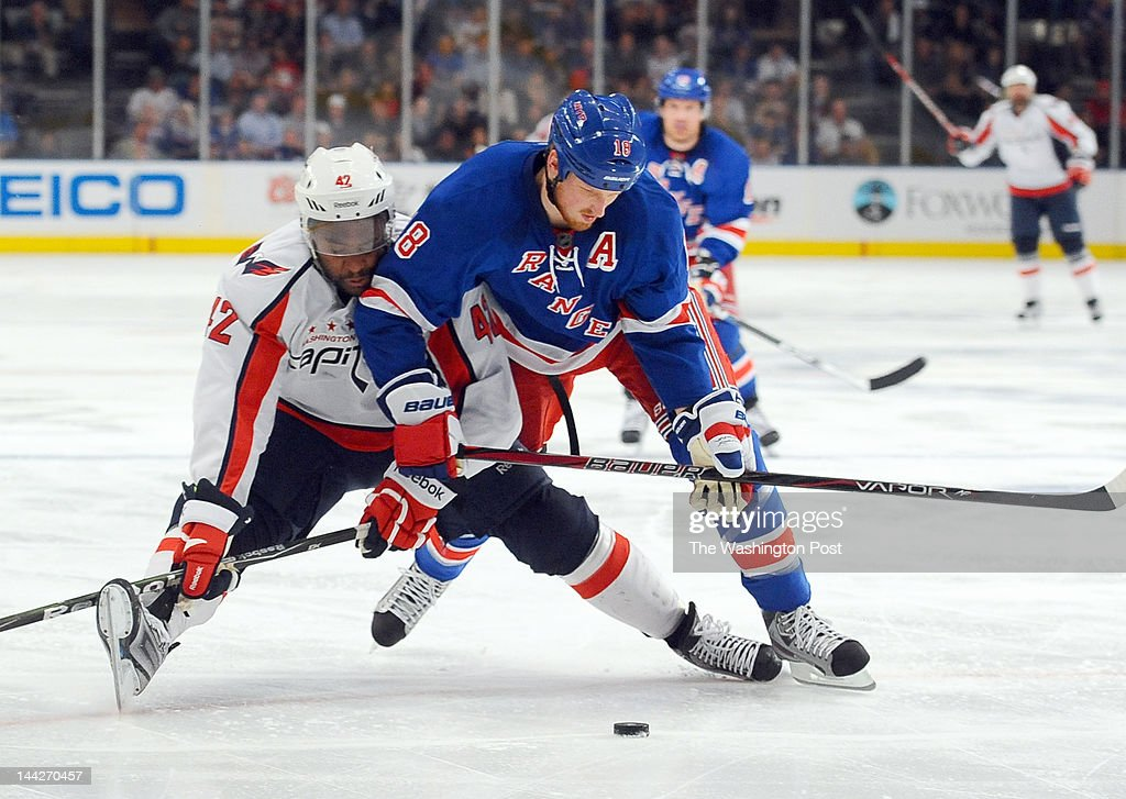 NEW YORK, NY May 12, 2012 Washington Capitals right wing Joel Ward (42) battles New York Rangers defenseman Marc Staal (18) during 2nd period action on May 12, 2012 in New York, NY