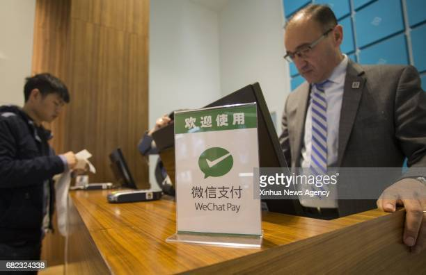A WeChat Pay logo is seen on a cashier desk of a shop at Yorkdale Shopping Centre in Toronto Canada May 11 2017 Canada's shopping mall Yorkdale...