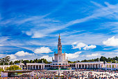 May 13th Celebration of Mary's Appearance Basilica of Lady of Rosary Bell Tower Fatima Portugal. Church created on site where three Portuguese Shepherd children saw Virgin Mary of the Rosary.  Basilic