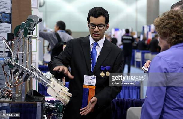 May 14 2014 Mina Fahmi age 17 from Hollywood Md presents his project a teleoperation robot to judges at the Intel International Science and...