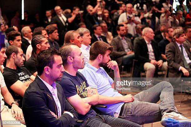 Xavi Hernandez Andres Iniesta and Gerard Pique in the Carles Puyol farewell ceremonyl held in the Auditorium 1899 of the FCB the May 15 2014 Photo...