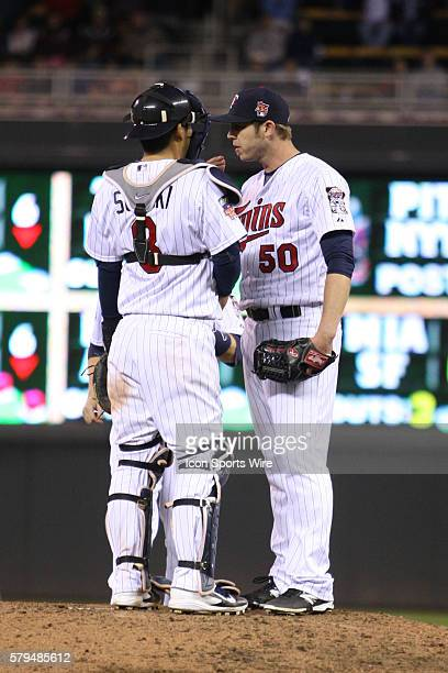 May 16 2014 Minnesota Twins catcher Kurt Suzuki steps out to the mound to talk to pitcher Casey Fien at the Minnesota Twins game versus Seattle...