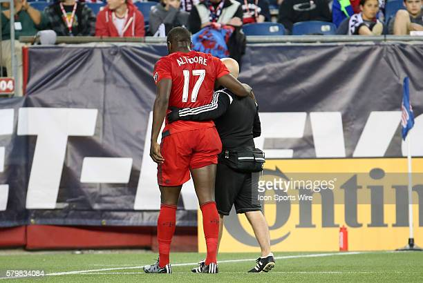 Toronto FC forward Jozy Altidore helped off the field by the team trainer after injuring his hamstring The New England Revolution and Toronto FC...