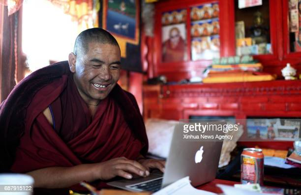 LHASA May 17 2017 Lama Ngawang Peljor practices typing at the Rongpu Monastery near Mount Qomolangma in southwest China's Tibet Autonomous Region May...