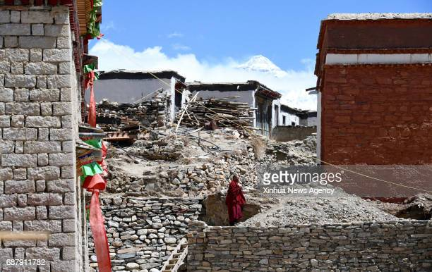 LHASA May 17 2017 Lama Ngawang Peljor walks to his dormitory at the Rongpu Monastery near Mount Qomolangma in southwest China's Tibet Autonomous...