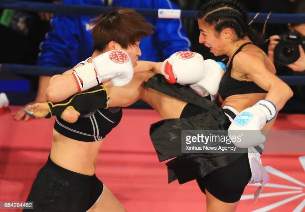 MISSISSAUGA May 17 2017 Ren Kailin of China fights against Farinaz Lari of Canada during the women's 52kg match of the 1st Annual Wu Lin Feng...