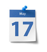 """A photograph of a calendar page with a blue band and the date - """"May 17th"""" - isolated on white."""