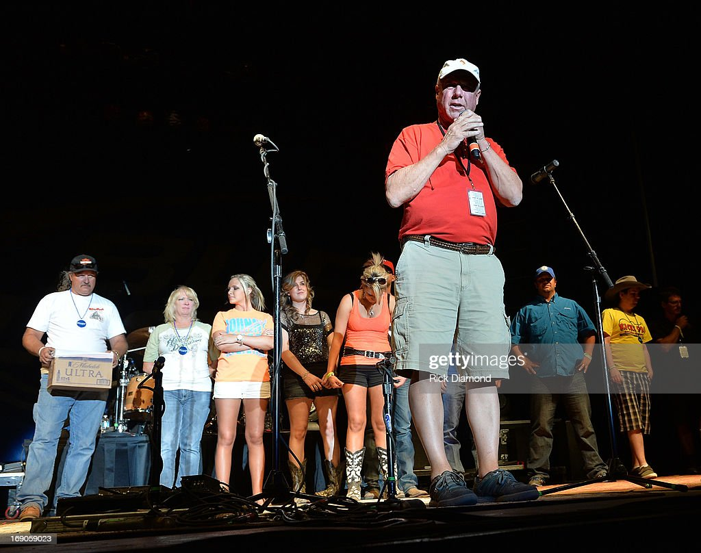 Mayor Tommy Muska of West, Texas on stage thanking the crowd for there contributions to West, Texas disaster fund at Texas Thunder Festival 2013 - Day 2. May 18, 2013 in Gardendale, Texas.