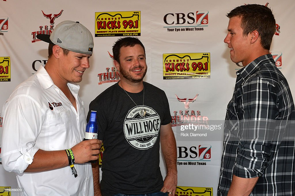 West, TX. Recording Artist Wade Bowen (center) visits with Jarrod and Heath Harris, sons of Capt. Kenneth 'Luckey' Harris, Jr, who was killed in the West, TX fertilizer plant explosion Wednesday, April 17th. Wade Bowen was spending time with Harris' sons at Texas Thunder Festival 2013 - Day 2. May 18, 2013 in Gardendale, Texas.