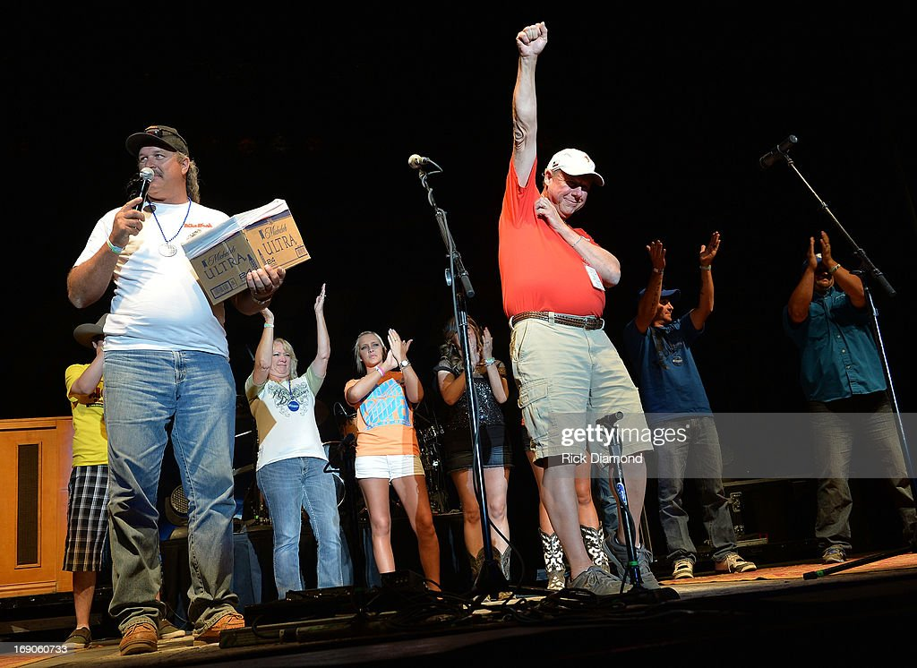 Ken Couch of Ken's Satellite & Potable Water Hauling. LLC (white shirt) and Mayor Tommy Muska of West, Texas (orange shirt) on stage thanking the crowd for their contributions to West, Texas disaster fund at Texas Thunder Festival 2013 - Day 2. May 18, 2013 in Gardendale, Texas.