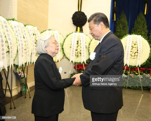 BEIJING May 18 2017 Chinese President Xi Jinping shakes hands with a family member of former Chinese Vice Premier Qian Qichen during the funeral of...