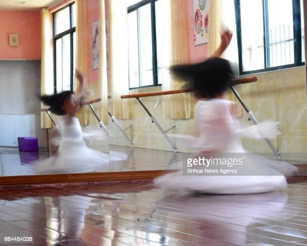 NANCHANG May 18 2017 Jiang Zhang Ziyi practices dancing at a dance studio of No 10 Primary School in the Xinzhou District of Shangrao east China's...