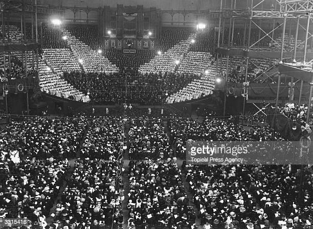Children singing the national anthem in front of a huge audience for the Festival of Empire at Crystal Palace London
