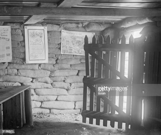 Inside the YMCA air raid shelter in the Strand Posters on the wall show life at the front