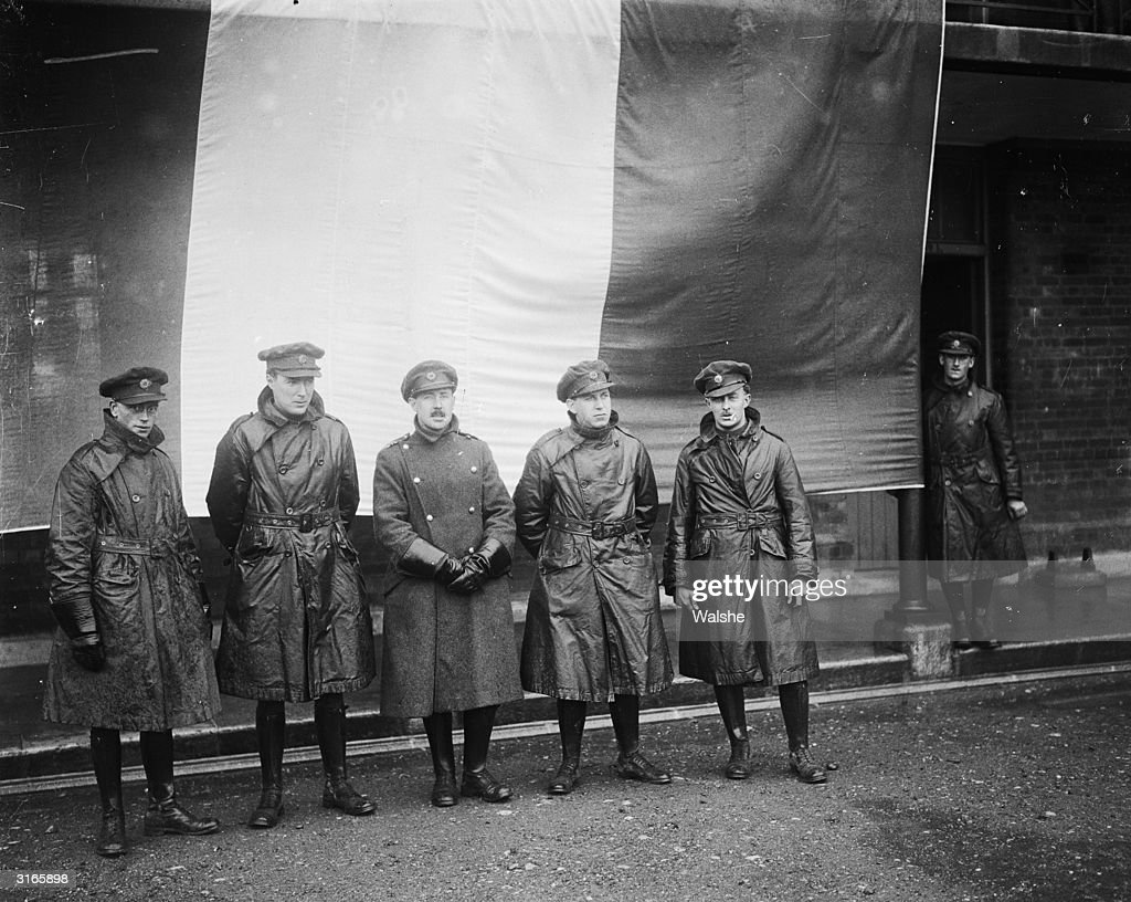 Irish Republican Army officers including General O'Connor lined up in front of the Tricolour Flag after the British evacuation of the Curragh...