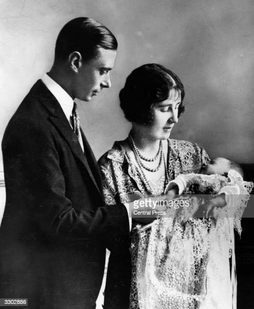 Future King and Queen George Duke of York and Elizabeth Duchess of York holding their first child future Monarch Princess Elizabeth at her...