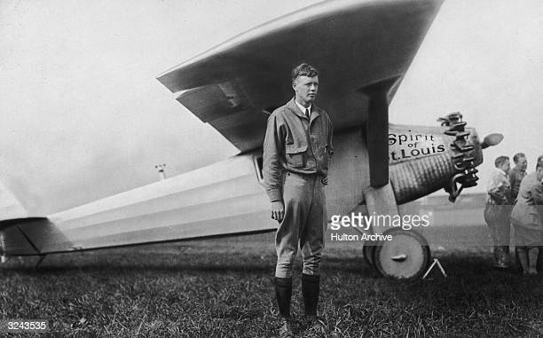 American aviator Charles Lindbergh poses next to his airplane the 'Spirit of St Louis'