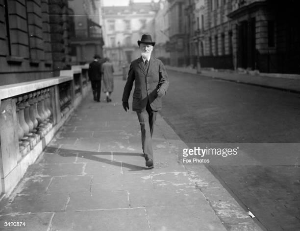 Irish dramatist and social critic George Bernard Shaw walking along the Strand in London