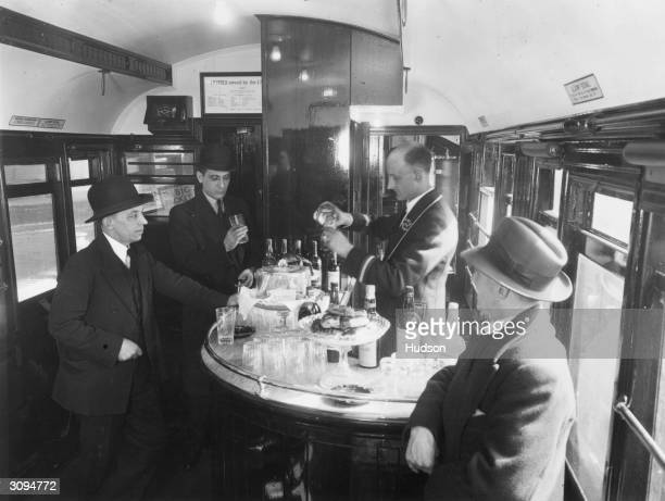 Men drink at the buffet carriage of a London and NorthEastern Railway train