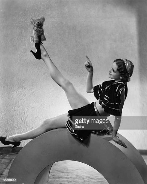 US dancer Thelma Bentley of the Palladium Fisher Girls balancing a teddy bear on the end of her shoe during a routine at the London Palladium