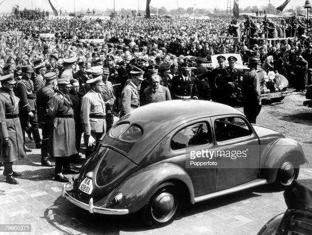 27 May 1938 German Chancellor and Nazi dictator Adolf Hitler inspects the new Peoples car at the Fallensleben German car factory designed to...
