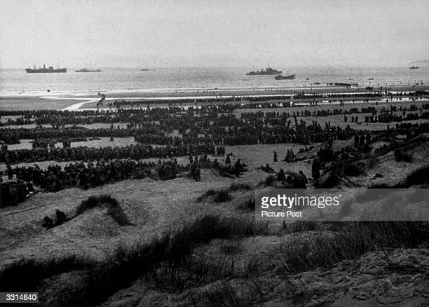 The evacuation of the British Expeditionary Force from Dunkirk beach Original Publication Picture Post 564 Dunkirk pub 1940