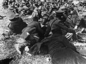 British officers resting with Greek and British prisoners on Crete which has been captured by German forces