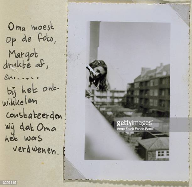EXCLUSIVE In a picture juxtaposed with a handwritten caption from Anne Frank's photo album Anne leans out of a window in Amsterdam Holland