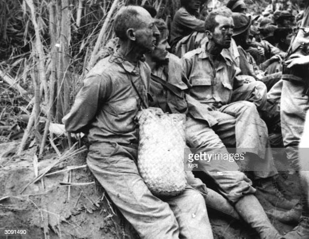 American and Filipino prisoners of war during the Bataan Death march when the Japanese forcemarched them across the Philippines