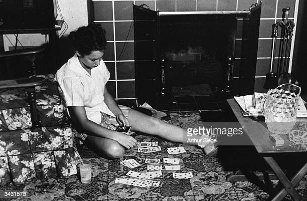 Nancy Fergusen playing solitaire in her home in Point Pleasant West Virginia