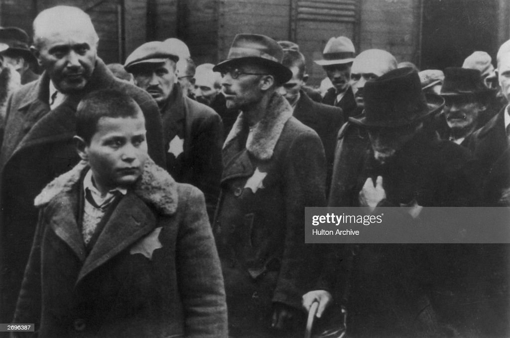 Jewish deportees with the yellow stars sewn on their coats arrive at Auschwitz concentration camp