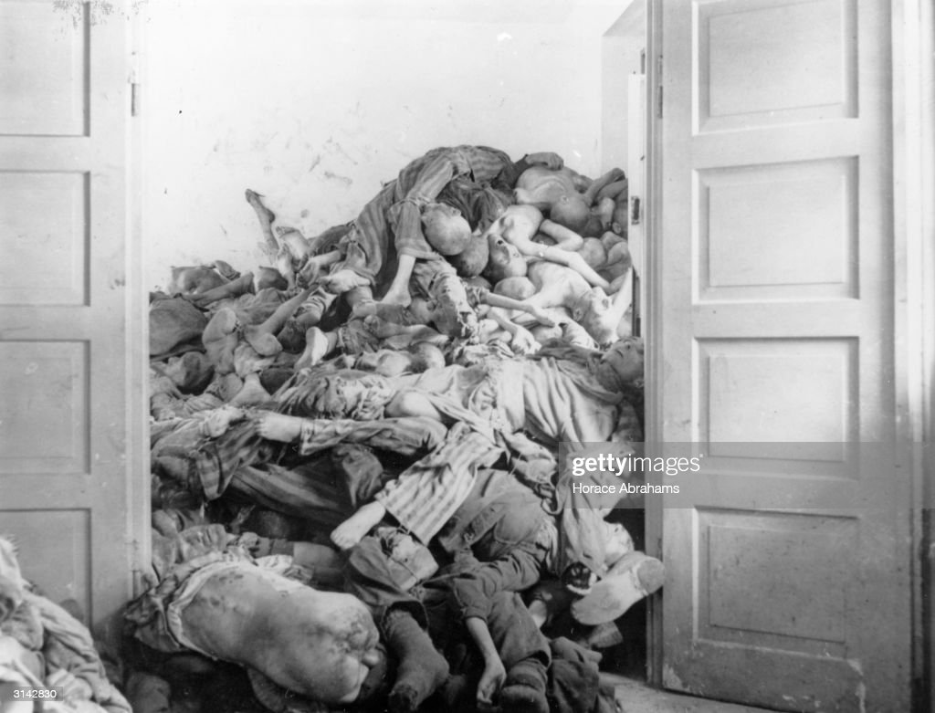 A pile of corpses found by troops of the US 7th Army at Dachau concentration camp in Germany. These prisoners had been gassed and their bodies were awaiting cremation.