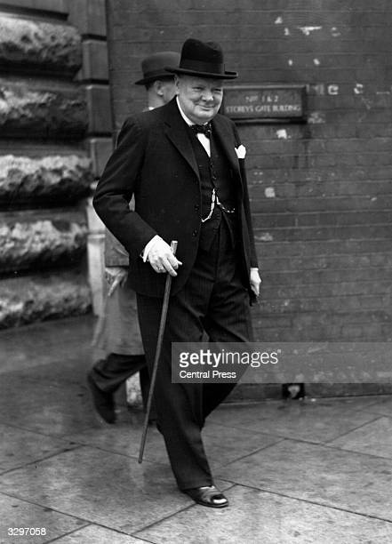British wartime prime minister Sir Winston Leonard Spencer Churchill leaving Downing Street for Buckingham Palace for a discussion with King George...