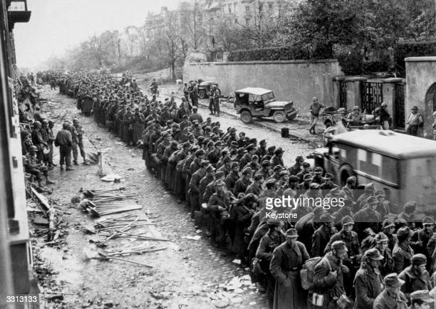 Hundreds of German prisoners line the streets after the final surrender of Aachen Germany