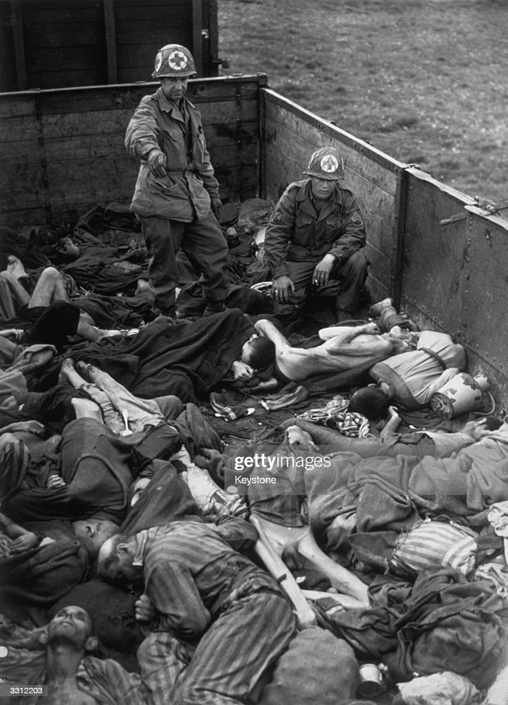 Piles of emaciated bodies lying in goods wagons at the concentration camp at Dachau, Germany, which was liberated by the American army. The bodies had been brought from other camps and consigned to the crematorium.
