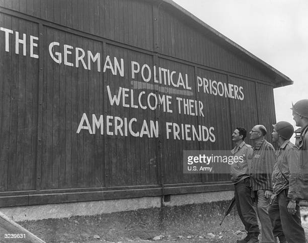 Soldiers of the 46th Armored Infantry 5th Armored Division US Ninth Army and their guide read 'THE GERMAN POLITICAL PRISONERS WELCOME THEIR AMERICAN...